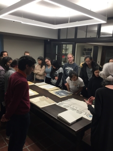 Students view Trinity College's Charter and other archival documents.
